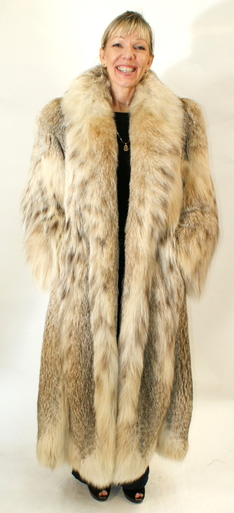Wolverine furs furs luxury outerwear accessories fur for Stor fur gartenteich